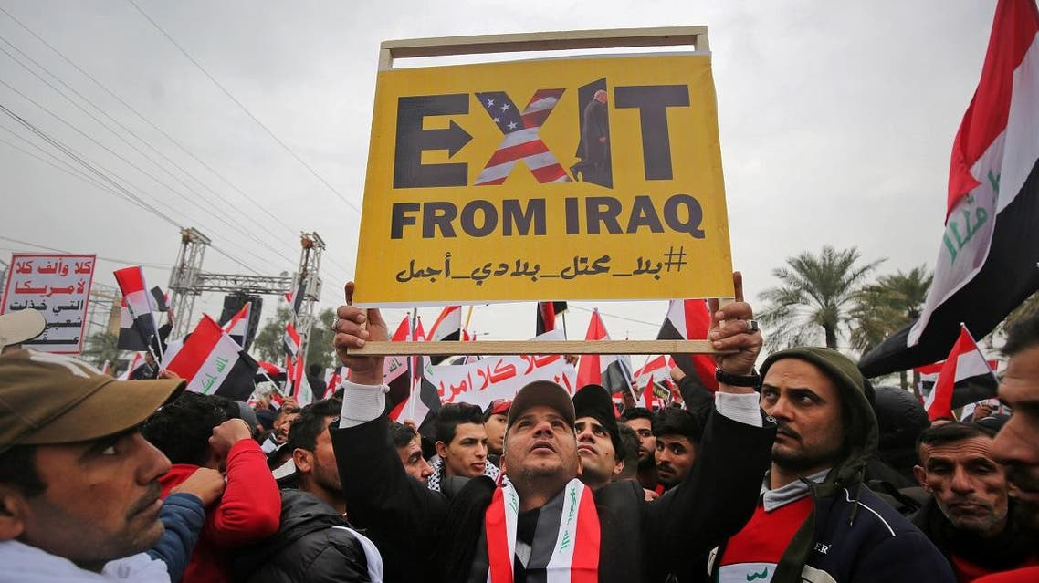 """Protesters raise a placard as supporters of Iraqi cleric Moqtada Sadr gather in the capital Baghdad for a """"million-strong"""" march to demand an end to the presence of US forces in their country. (AFP)"""