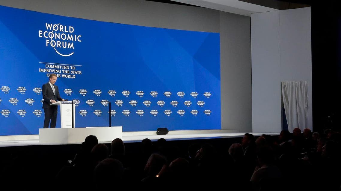 The President of the World Economic Forum Borge Brende stands on the stage. (AP)