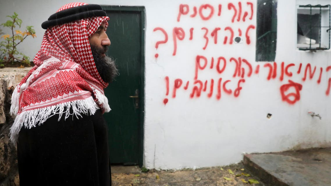 Palestinians visit vandalized mosque in the Arab neighborhood of Beit Safafa, in east Jerusalem on Jan. 24, 2020. (AP)