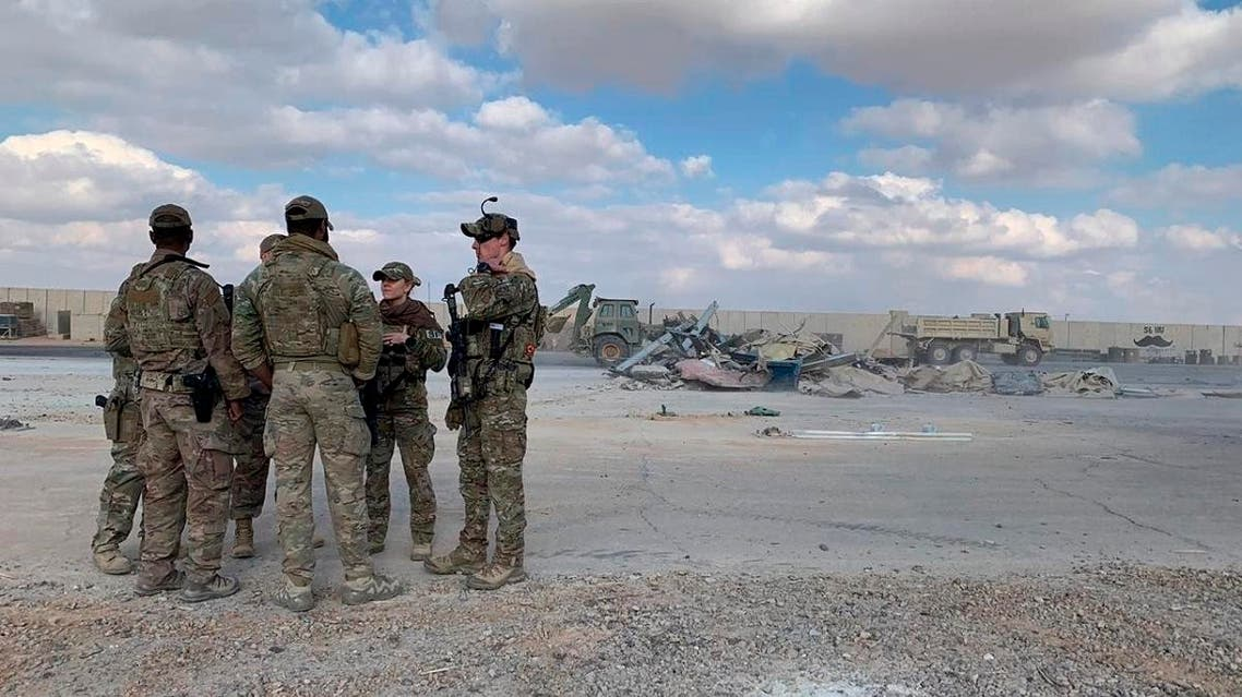 U.S. Soldiers stand while bulldozers clear rubble and debris at Ain al-Assad air base in Anbar, Iraq, Monday, Jan. 13, 2020. (AP)
