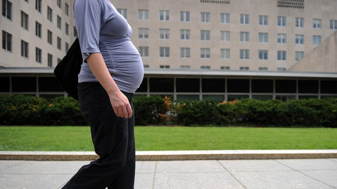 In this file photo taken on August 5, 2010 a pregnant woman walks past the US State Department in Washington. (AFP)