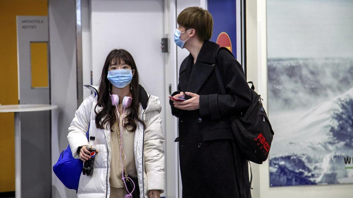Air travellers wear masks as they arrive at Ivalo Airport, Finland on January 24, 2020. (Reuters)