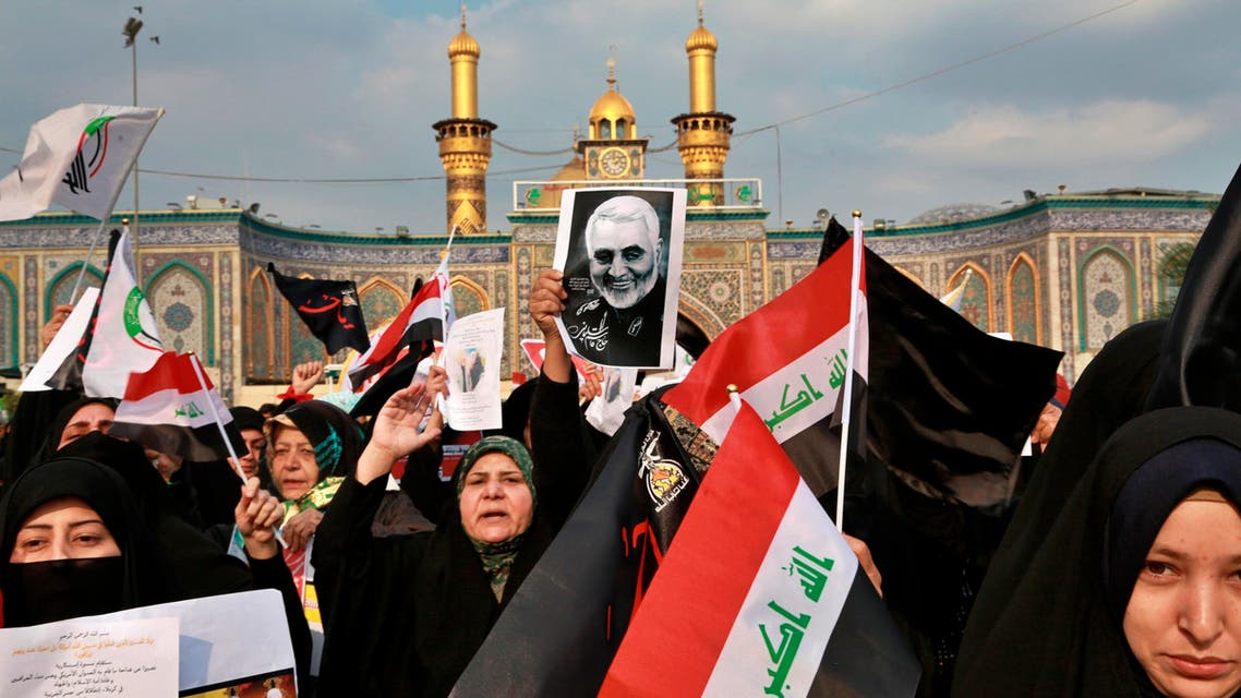 Shiite Muslims demonstrate over the U.S. airstrike that killed Iranian Revolutionary Guard Gen. Qassem Soleimani, in the posters, in Karbala on Jan. 4, 2020.. (AP)