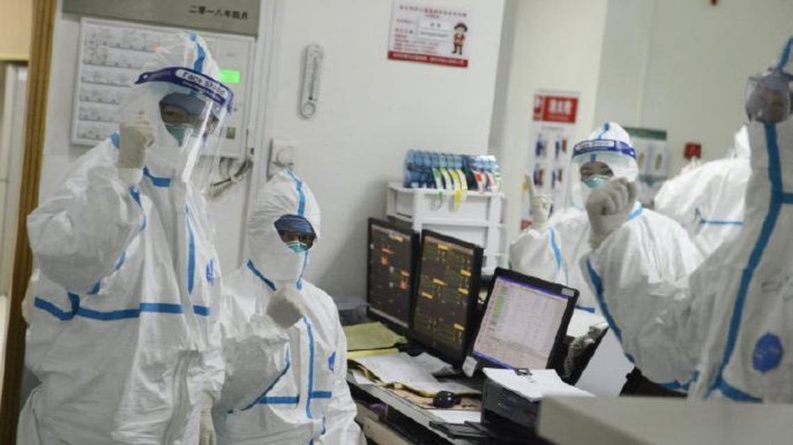 A picture released by the Central Hospital of Wuhan shows medical staff attending to patient at the The Central Hospital Of Wuhan Via Weibo in Wuhan. (Reuters)