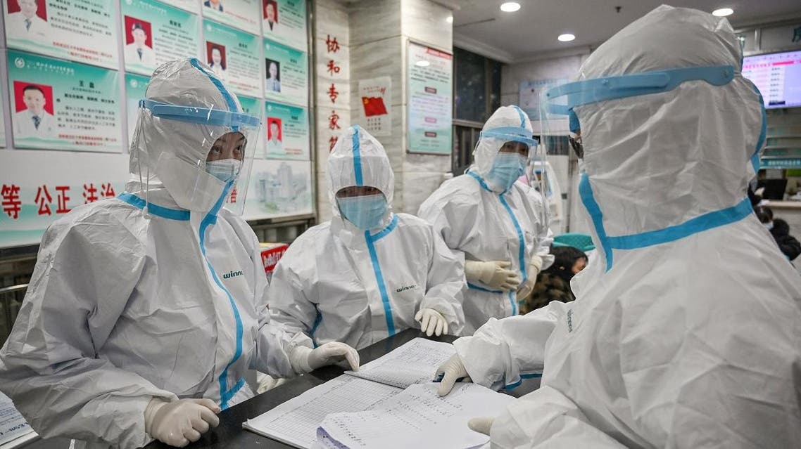 Medical staff members wearing protective clothing to help stop the spread of a deadly virus which began in the city, work at the Wuhan Red Cross Hospital in Wuhan on January 25, 2020. (AFP)