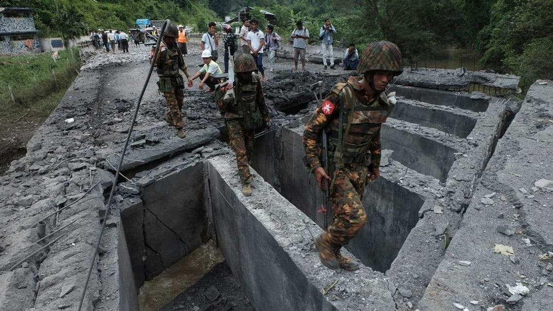 Soldiers walk over Gote Twin bridge damaged by explosion Thursday, Aug. 15, 2019, in Gote Twin, Naung Cho township, northern Shan State, Myanmar.  (AFP)
