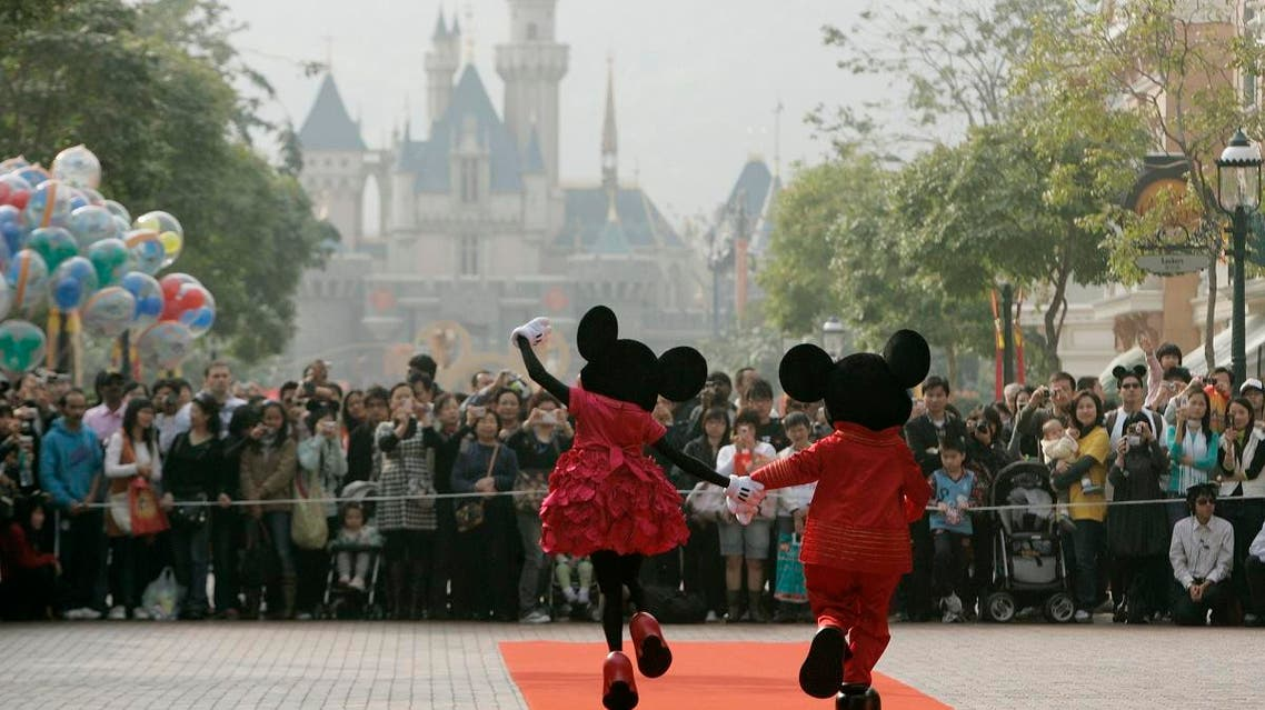 People dressed as cartoon characters Mickey and Minnie greet visitors with their latest Year of the Mouse costumes at Hong Kong Disneyland January 21, 2008. (Photo: Reuters)