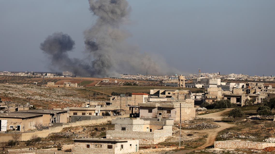 Smoke billows above building during recent air strikes by pro-regime forces in the jihadist-held city of Maaret al-Numan in Syria's northwestern Idlib province, on January 25, 2020. Regime forces, backed by Russian warplanes, have increased their attacks on southern Idlib since December, displacing more than 358,000 people, according to the United Nations.