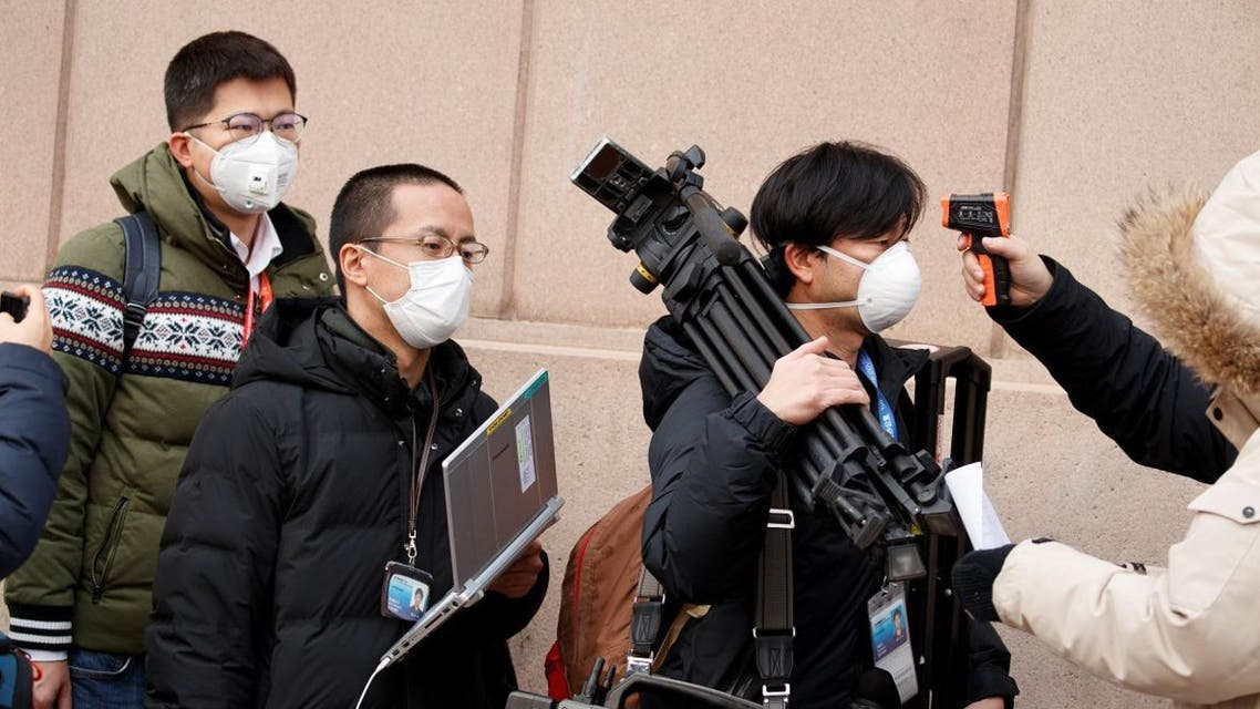 Members of the media have their temperature checked before attending a news conference by the State Council Information Office about the outbreak of the new coronavirus in Beijing, China, January 26, 2020. (Photo: Reuters)