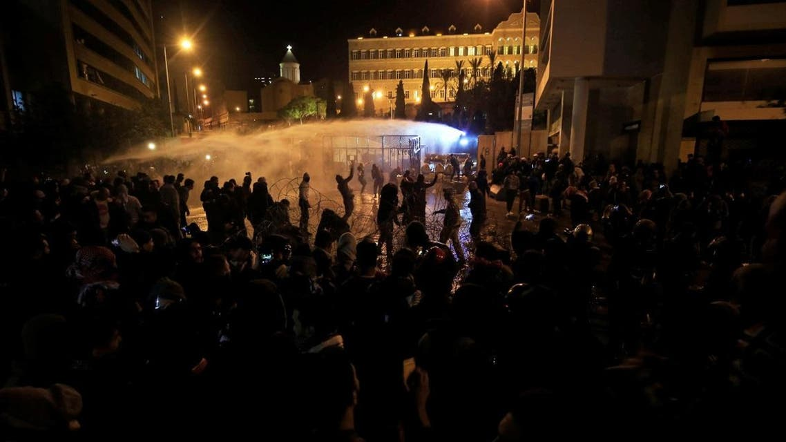 Demonstrators are sprayed by a water cannon during a protest against the newly formed government outside the government headquarters in downtown Beirut, Lebanon January 25, 2020. (Photo: Reuters)