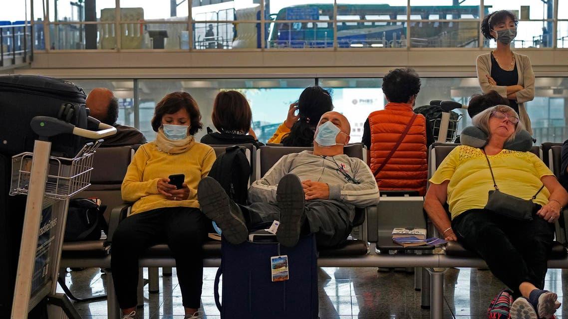 Passengers wear masks as they wait at the Hong Kong International Airport in Hong Kong Saturday, Jan. 25, 2020. (AP)