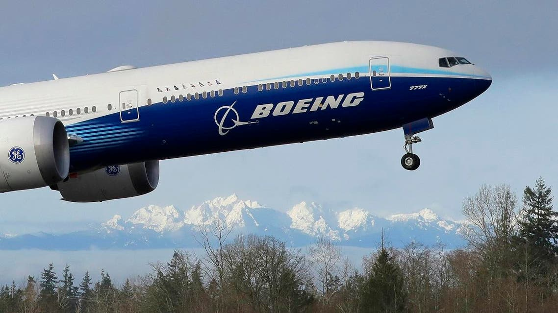 A Boeing 777X airplane takes off on its first flight with the Olympic Mountains in the background at Paine Field, Saturday, Jan. 25, 2020, in Everett, Wash. (AP)