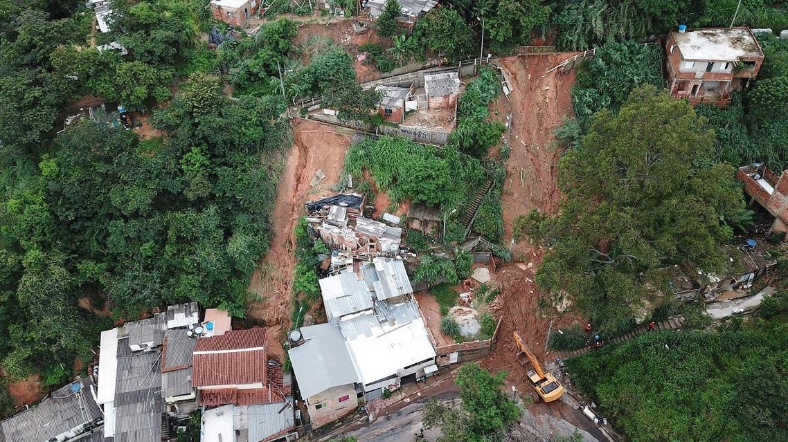 Aerial view showing rescue workers searching for five victims who were buried by a landslide in Jardim Alvorada neighbourhood in Belo Horizonte, state of Minas Gerais, Brazil. (AFP)