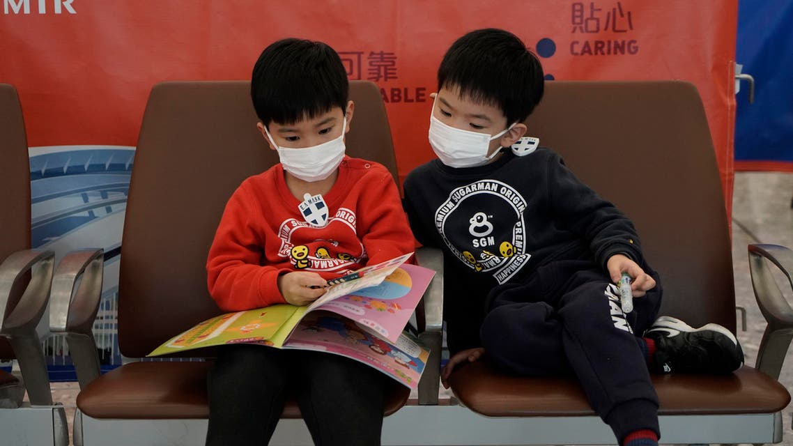 Passengers wear masks to prevent an outbreak of a new coronavirus in the high speed train station, in Hong Kong. (AP)