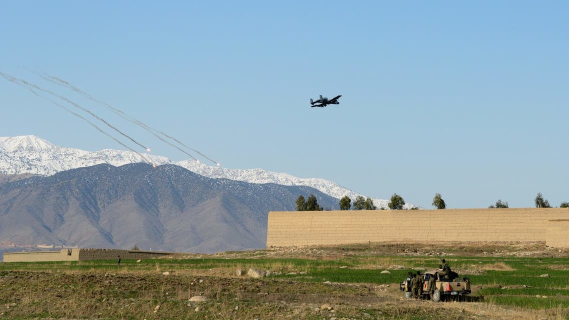 In this photograph taken on March 19, 2014, A US A-10 thunderbolt fighter plane releases flares as he flies low near Afghan soldiers positions of the 4th Brigade, 201 Army Corps of the Afghan National Army (ANA) and US Special Forces units during an operation in Khogyani District. The men of the Afghan army's fourth infantry brigade have been tasked with clearing the Taliban from Khogyani and Sherzad districts of the restive province of Nangarhar, ahead of the April 5, presidential election first round. AFP PHOTO/ROBERTO SCHMIDT
