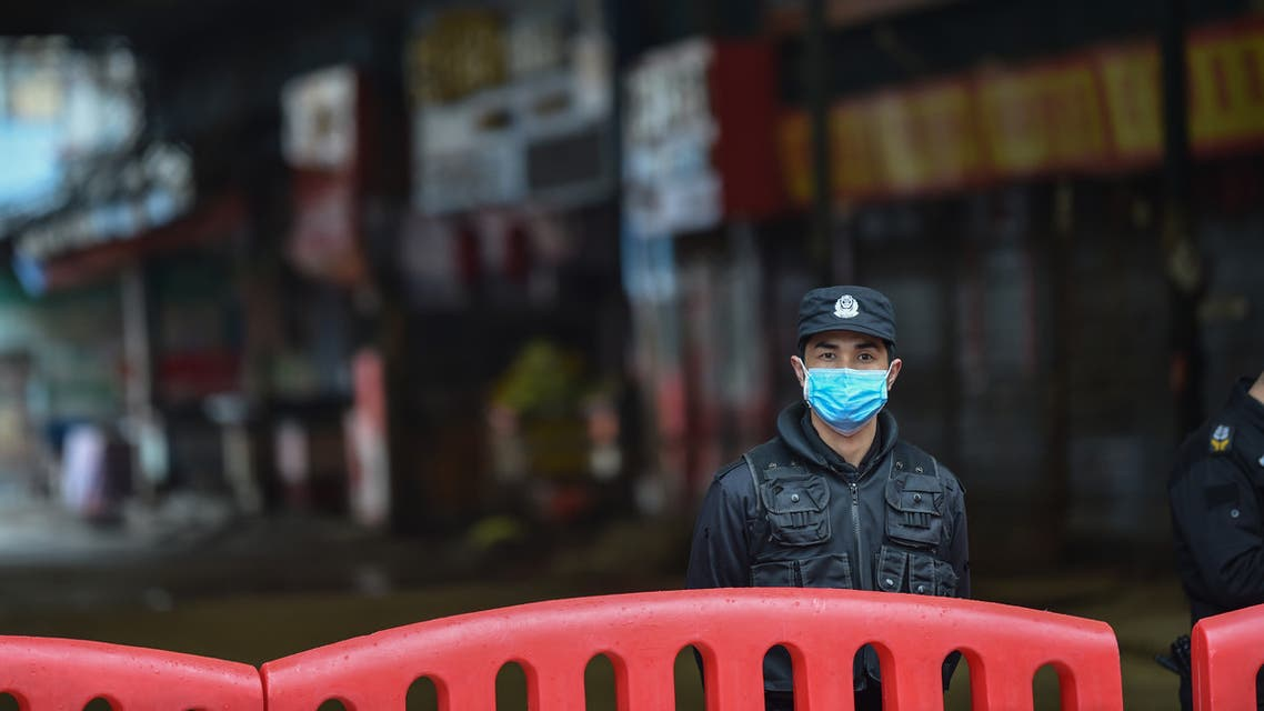 A security guard stands outside the Huanan Seafood Wholesale Market where the coronavirus was detected in Wuhan on January 24, 2020. The death toll in China's viral outbreak has risen to 25, with the number of confirmed cases also leaping to 830, the national health commission said.