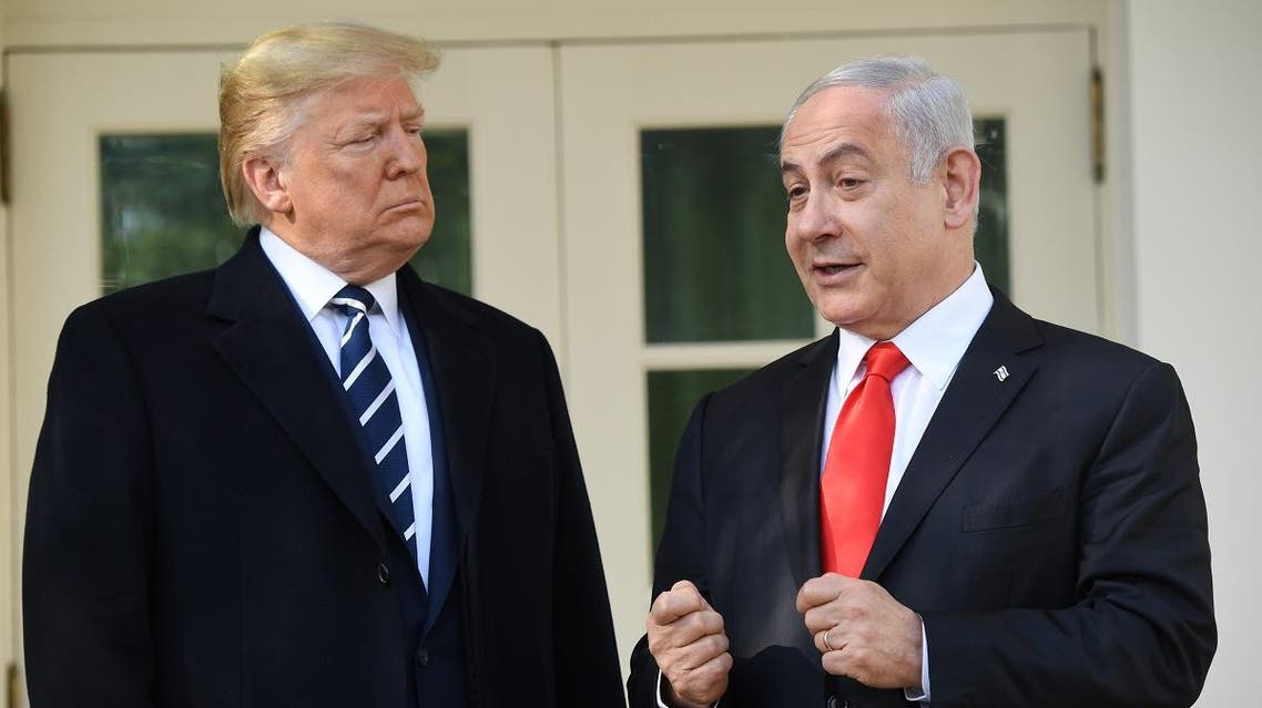 US President Donald Trump greets Israeli Prime Minister Benjamin Netanyahu as he arrives for meeting on the South Lawn of the White House in Washington, DC, January 27, 2020. (AFP)