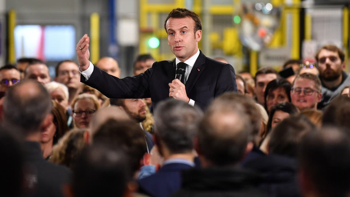 French President Emmanuel Macron speaks during a visit at the AstraZeneca factory in Dunkirk, northern France, on January 20, 2020, before the summit Choose France.