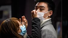 WHO chief says confident in China's ability to contain virus, urges calm