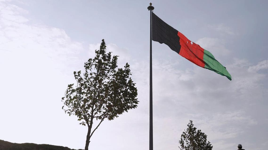 A man walks under Afghanistan's national flag in the early morning in Kabul, Afghanistan September 2, 2019. (File photo: Reuters)