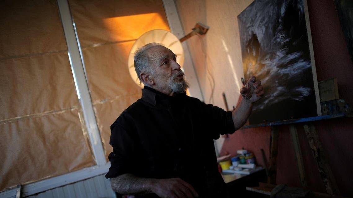 Artist Stamen Karamfilov gestures at his studio in the city of Plovdiv, Bulgaria, January 23, 2020. (Reuters)