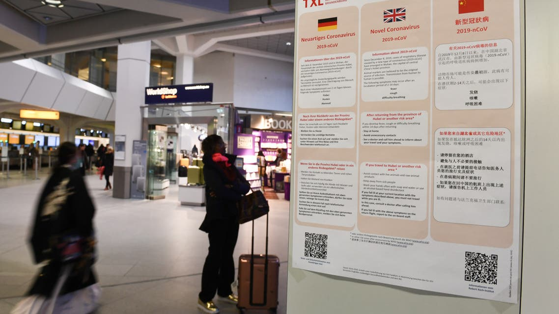 A poster with information about the coronavirus (2019-nCoV) is displayed at Tegel Airport in Berlin, Germany, January 26, 2020. REUTERS/Annegret Hilse