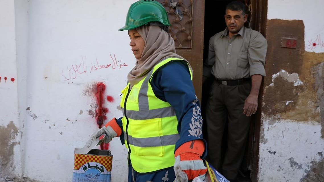 Jordanian woman Saada Turkmani picks up trash from a home as part of a women-run program to improve Jordan's solid waste management, in Shouneh, Jordan, January 15, 2020. (Photo: Reuters)