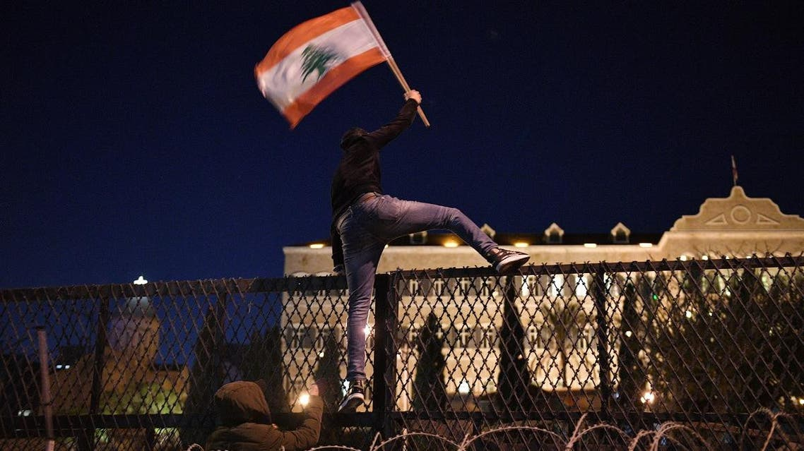 Protesters attack barriers in front of the Grand Serail, the prime minister's headquarters, in Beirut, Lebanon. (Greg Demarque)