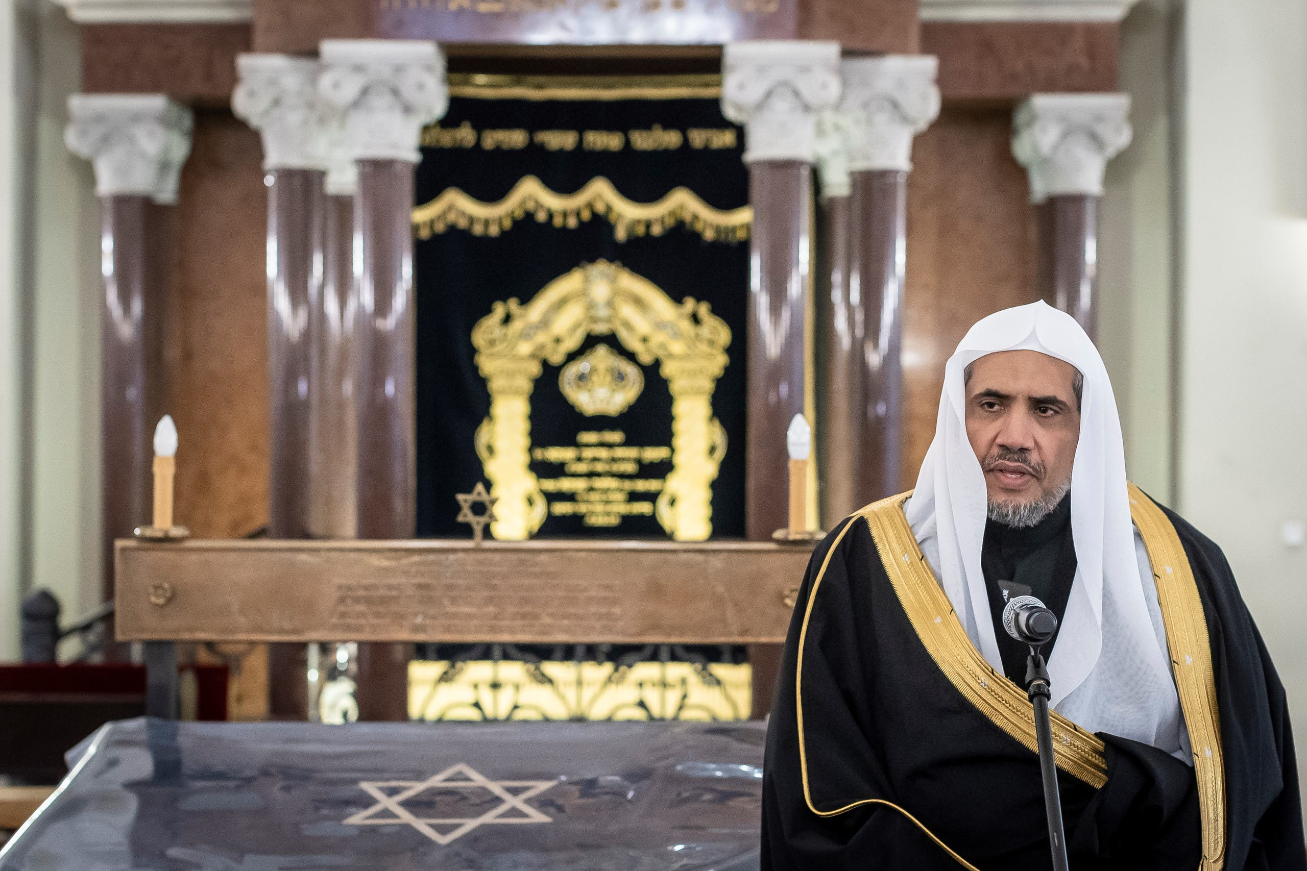 Secretary General of the Muslim World League Mohammad Abdulkarim al-Issa gives a speech during a visit to the Nozyk Synagogue on January 24, 2020 in Warsaw. (AFP)