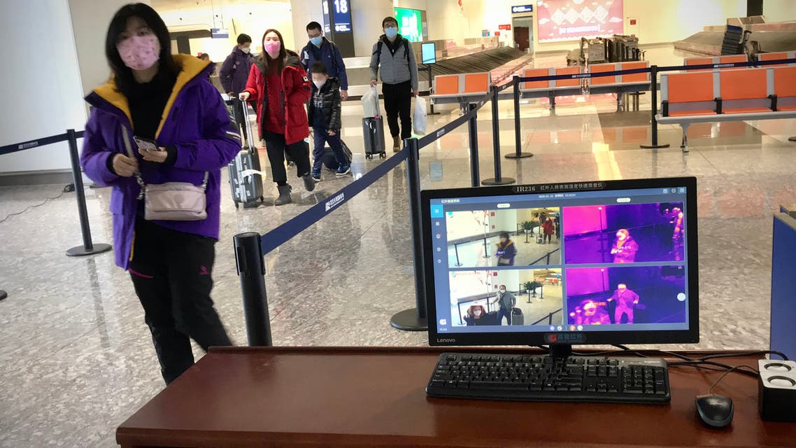 A thermal scanner set up to screen arriving passengers for fever is pictured at Tianhe airport in Wuhan in China's central Hubei province on January 23, 2020. China banned trains and planes from leaving a major city at the centre of a virus outbreak on January 23, seeking to seal off its 11 million people to contain the contagious disease that has claimed 17 lives, infected hundreds and spread to other countries.