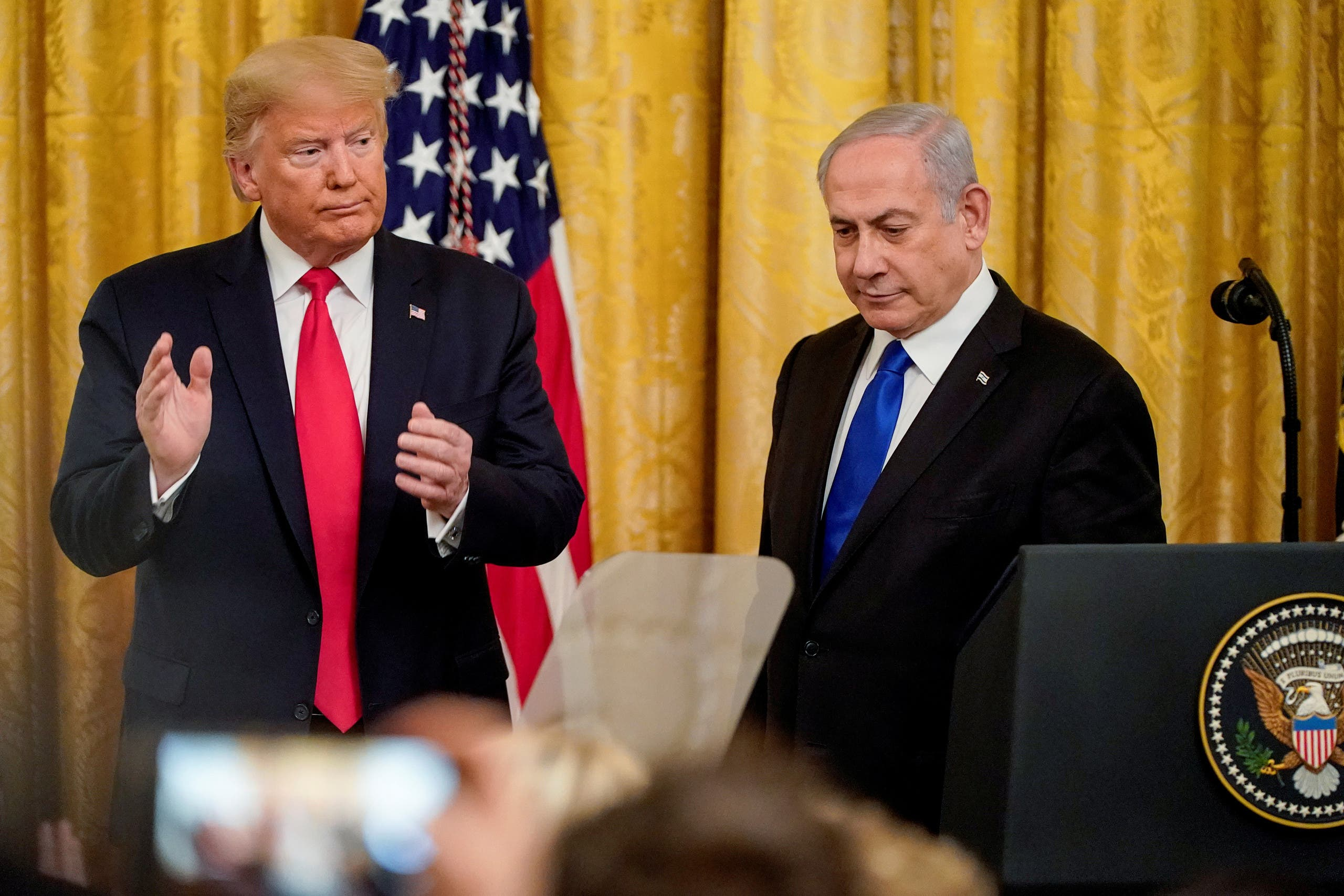 Trump applauds Netanyahu as they deliver joint remarks to discuss a Middle East peace plan at the White House in Washington, US, January 28, 2020. (Reuters)