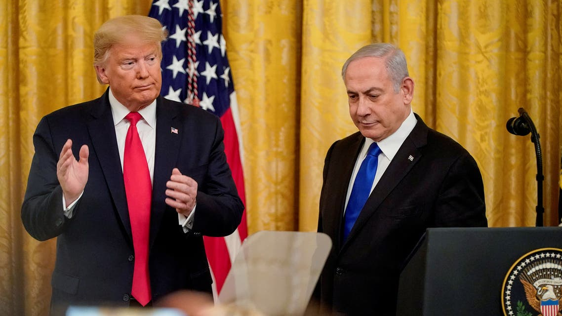 U.S. President Donald Trump applauds Israel's Prime Minister Benjamin Netanyahu as they deliver joint remarks to discuss a Middle East peace plan proposal in the East Room of the White House in Washington, U.S., January 28, 2020. REUTERS/Joshua Roberts