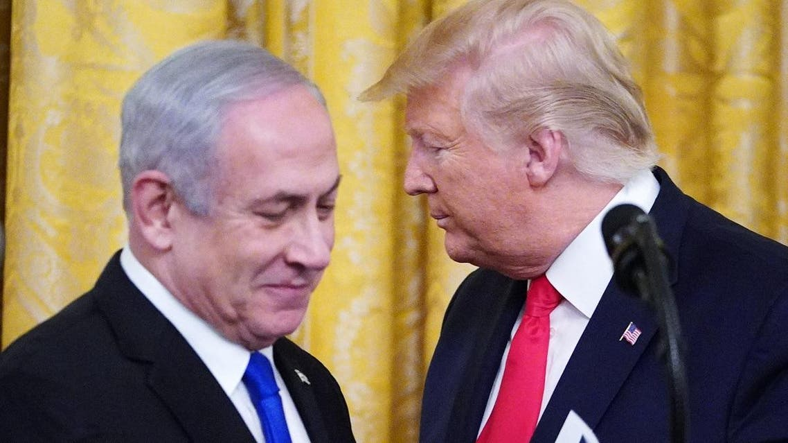 President Trump and Israel's PM Netanyahu take part in an announcement of Trump's Middle East peace plan in the East Room of the White House in Washington, DC on January 28, 2020. (AFP)