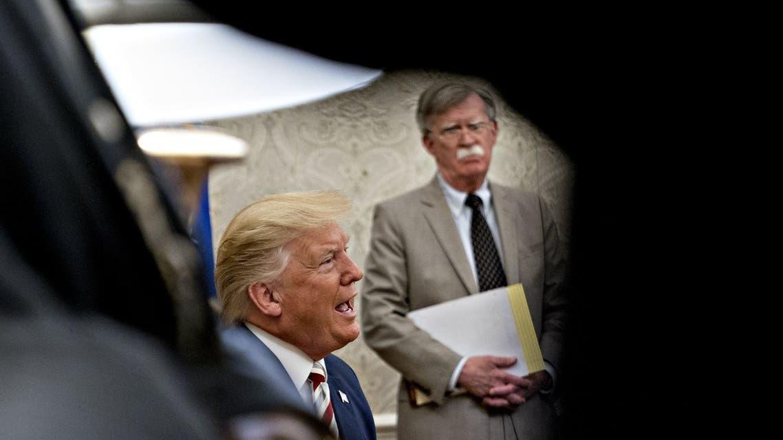 الرئيس دونالد وترمب ومستشار الأمن القومي السابق جون بولتون