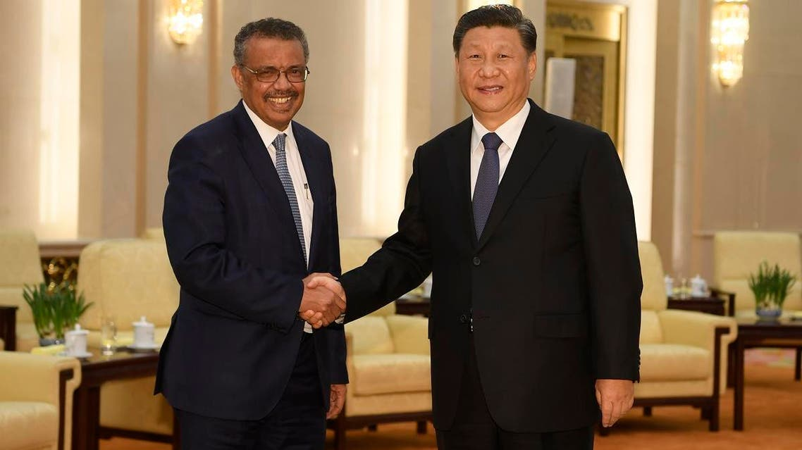 World Health Organization director general Tedros Adhanom (L) shakes hands with Chinese President Xi jinping before a meeting at the Great Hall of the People in Beijing on January 28, 2020. (AFP)