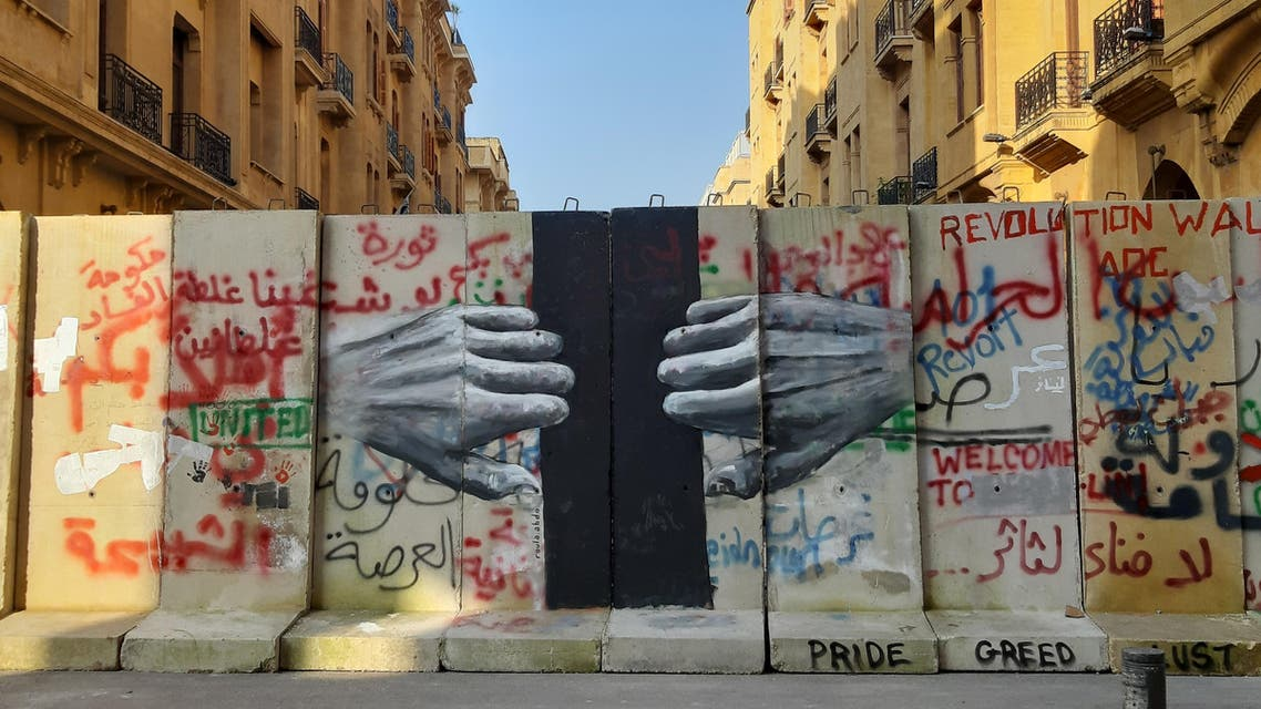 A mural painted by Roula Abdo on Jan. 26 on one one of the new walls erected in downtown Beirut to block access to the Parliament building. (Abby Sewell)