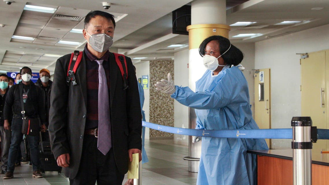 Passengers arriving from a China Southern Airlines flight from Changsha in China are screened for the new type of coronavirus, upon their arrival in Nairobi, Kenya on Jan. 29, 2020. (AP)