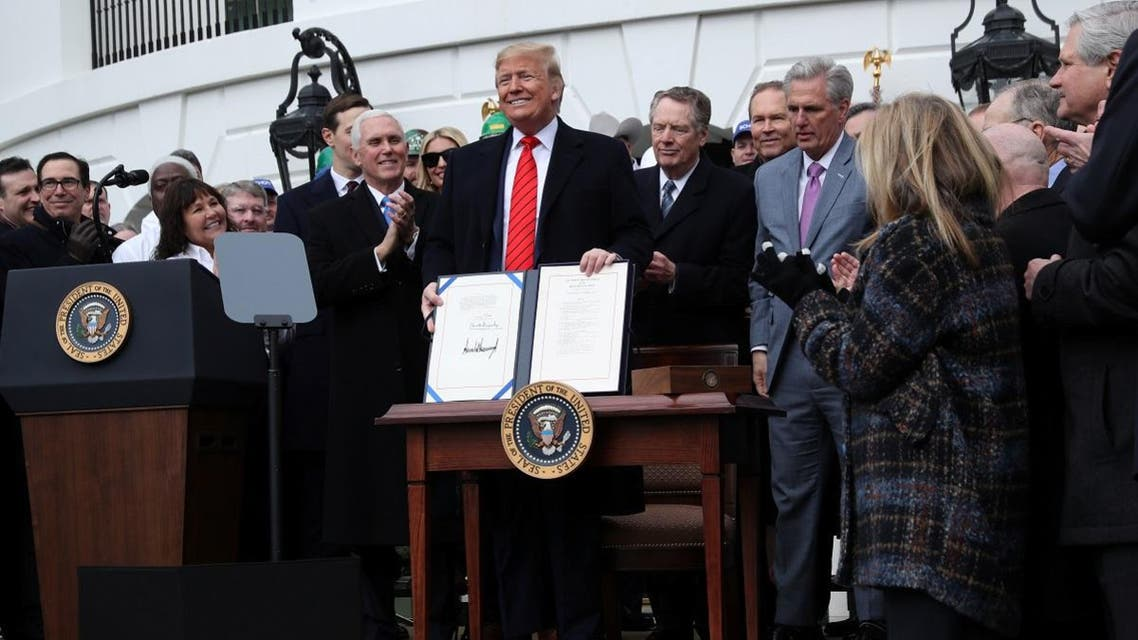 US President Trump signs USMCA trade deal at the White House in Washington. (Reuters)