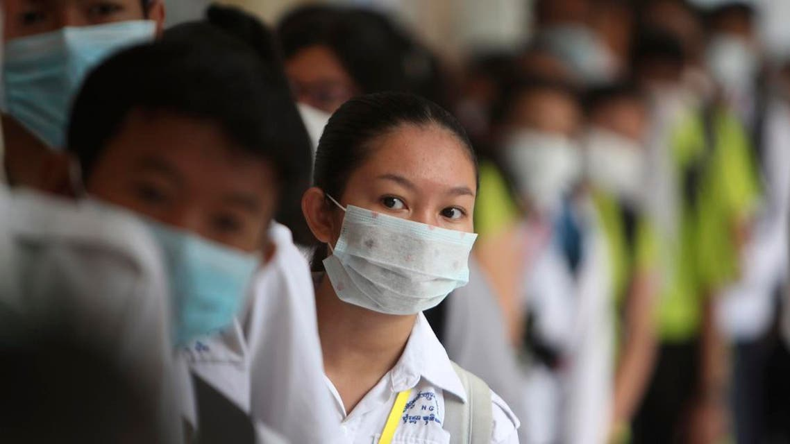 Students line up to sanitize their hands to avoid the contact of coronavirus before their morning class at a hight school in Phnom Penh, Cambodia. (Photo: AP)