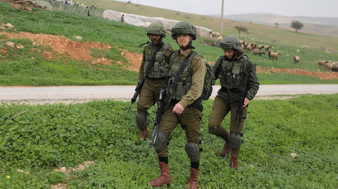 Israeli soldiers patrol past a field near al-Hamra checkpoint in the Jordan Valley in the occupied West Bank. (AFP)