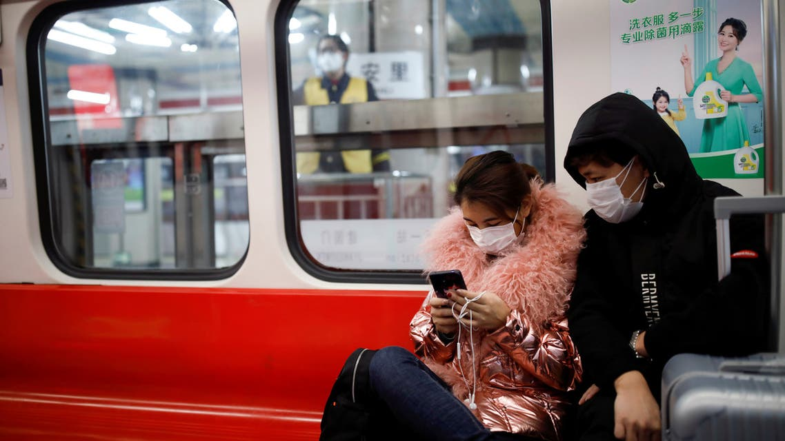 FILE PHOTO: People wearing masks travel in the subway, as the country is hit by an outbreak of the new coronavirus, in Beijing, China January 28, 2020. REUTERS/Carlos Garcia Rawlins/File Photo