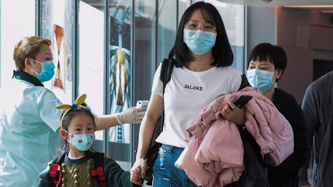 coronavirus people being screened at Singapore airport - AFP