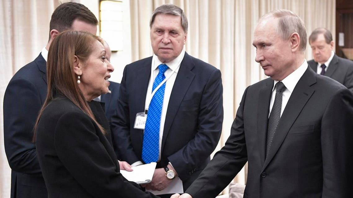 Russian President Vladimir Putin, right, shakes hands with Yaffa Issachar, mother of Israeli citizen Naama Issachar who is jailed in Russia for drug trafficking. (Photo: AP)