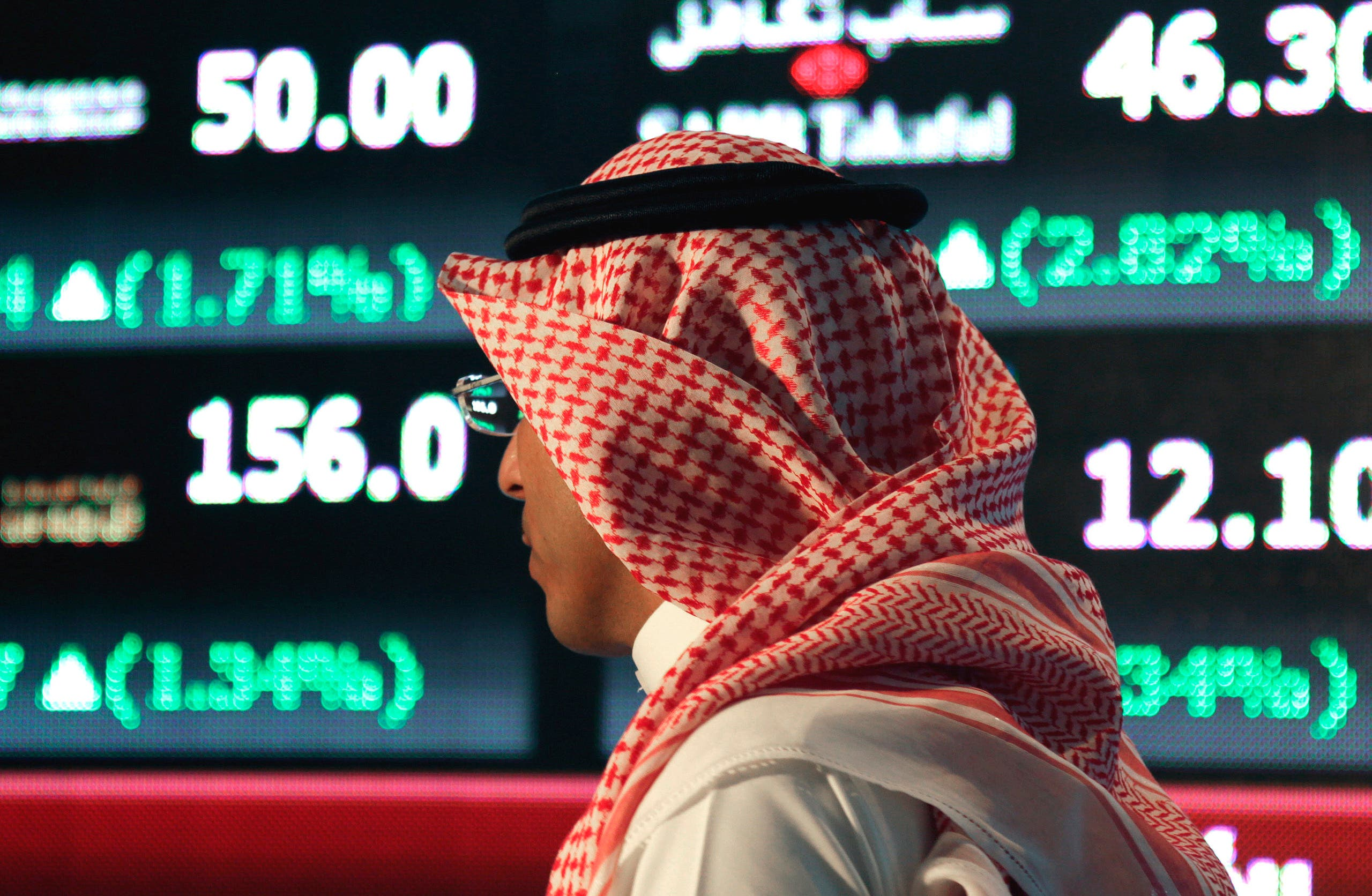 A Saudi man walks at the Tadawul Saudi Stock Exchange, in Riyadh, Saudi Arabia. (File photo: AP)
