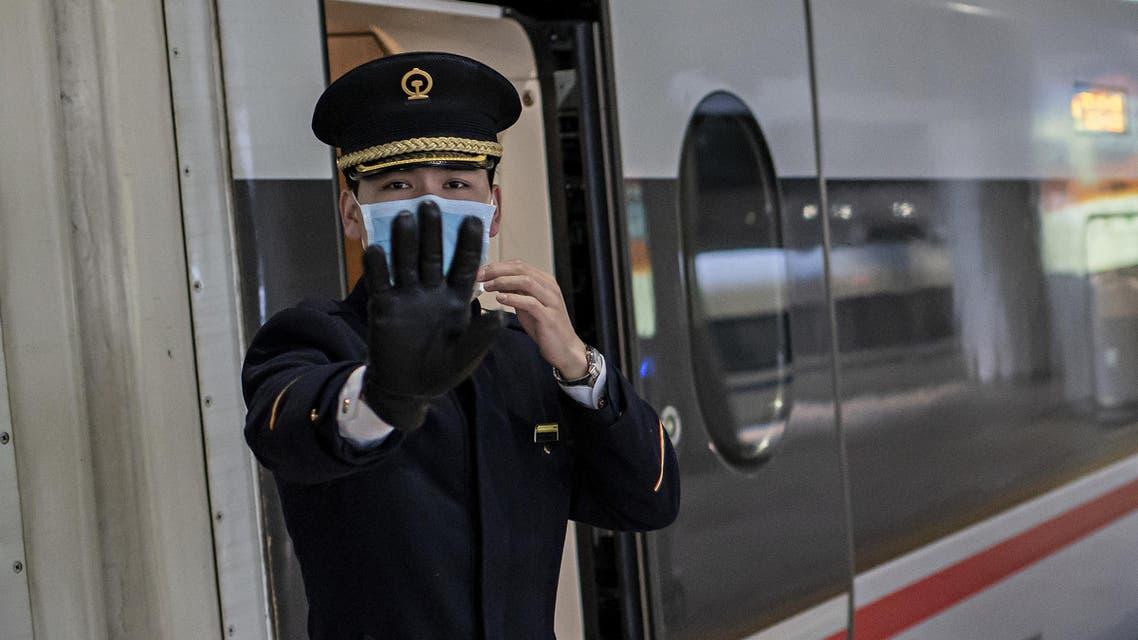 Coronavirus train man stop sign AFP