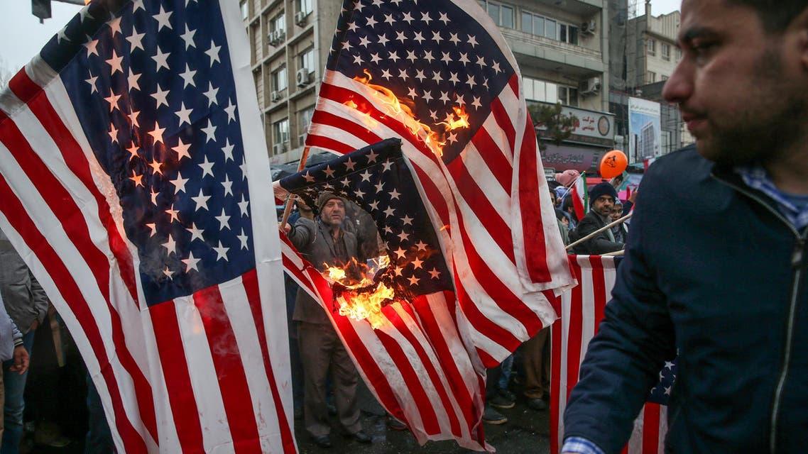Iranians burning US flags (Reuters)