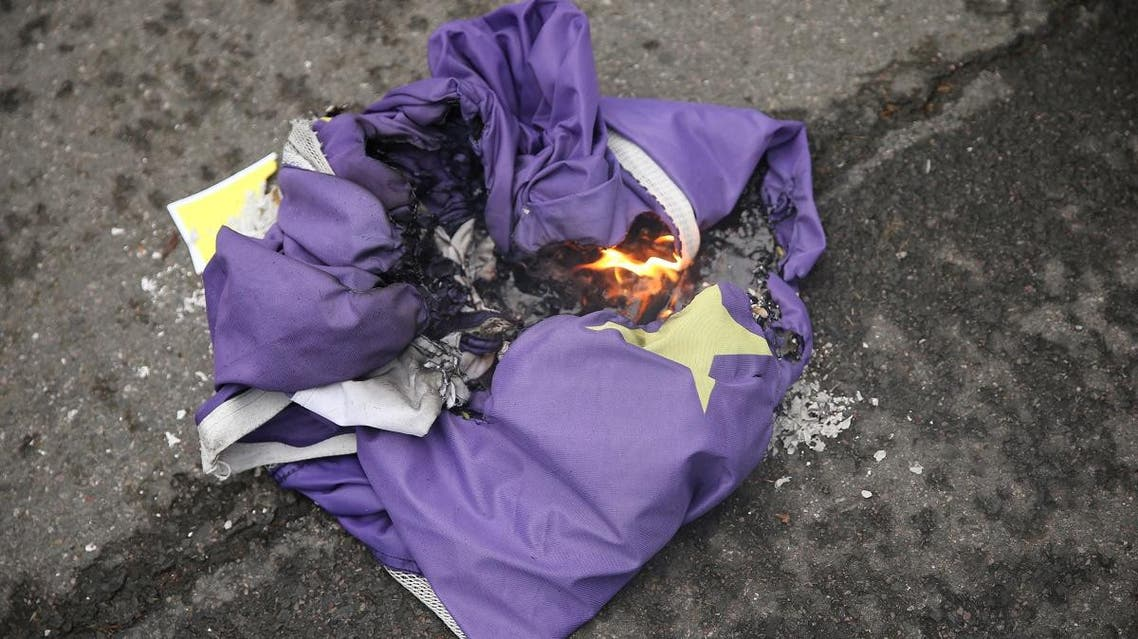 Brexit supporters burn an EU flag in Parliament Square in London on January 31, 2020 on the day that the UK formally leaves the EU. (AFP)