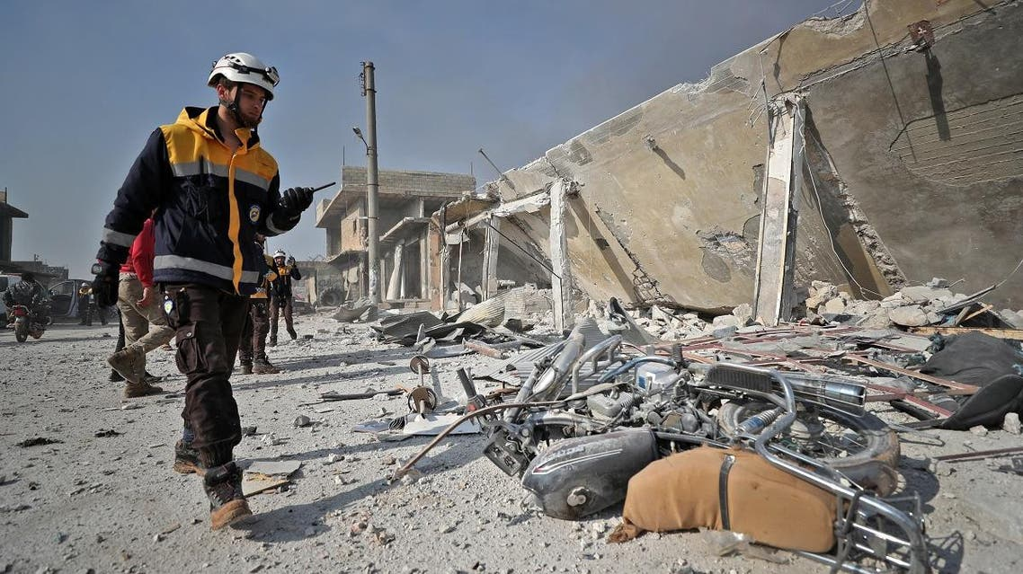 Members of the Syrian Civil Defense, also known as the White Helmets, inspect the scene following a reported Russian air strike in the town of Saraqib in the northwestern Idlib province. (File photo: AFP)
