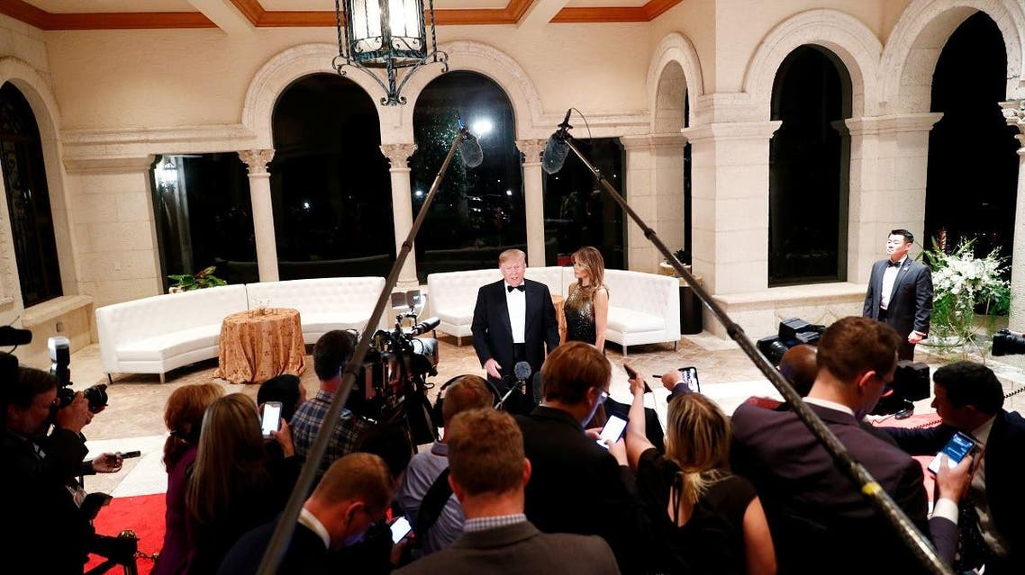 U.S. President Donald Trump accompanied by first lady Melania Trump, speaks to the press at the Mar-a-Lago resort in Palm Beach, Florida, U.S. December 31, 2019. REUTERS