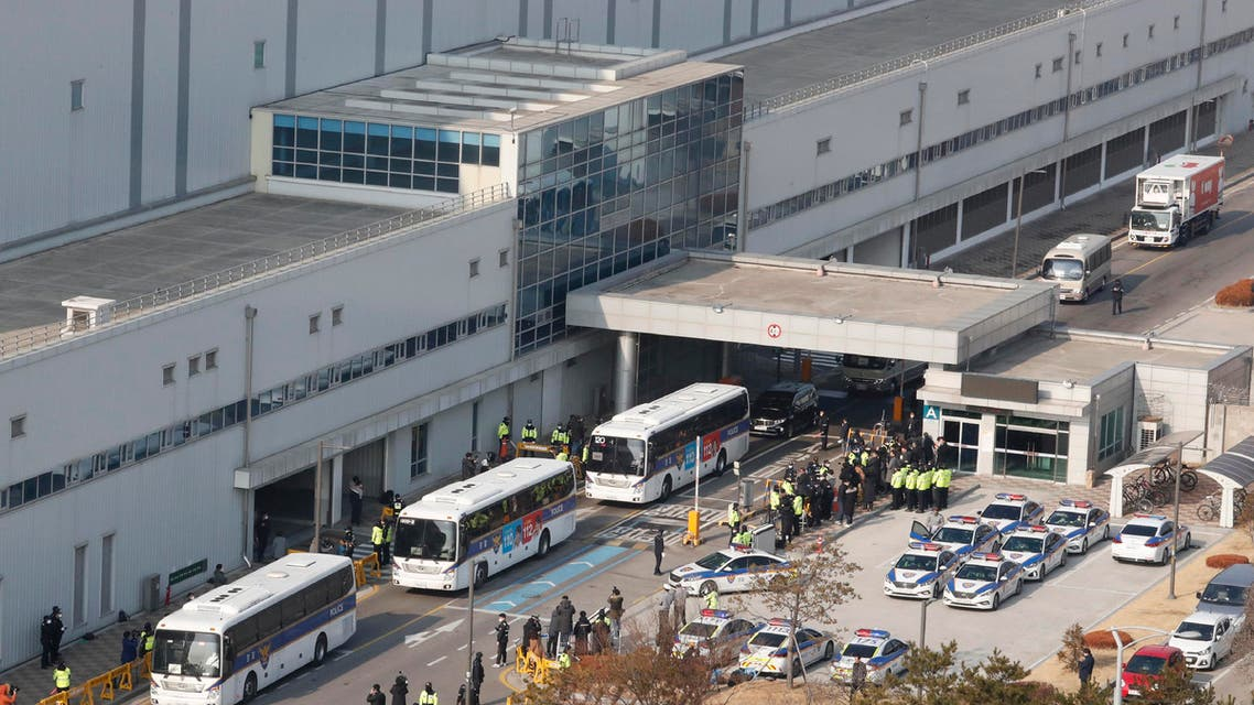 Buses carrying some South Korean evacuees from Wuhan, China, leave after arriving at Gimpo airport in Seoul, South Korea (AP)